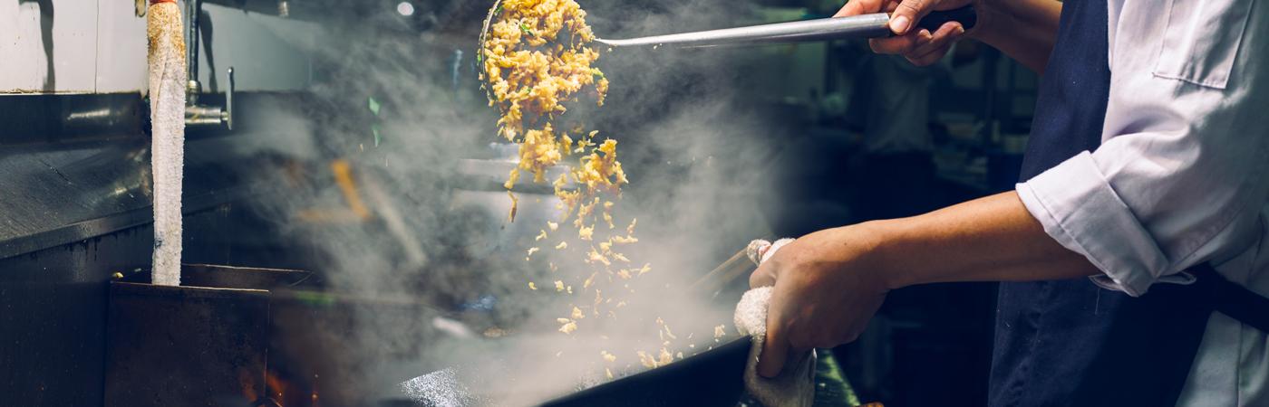 man cooking rice